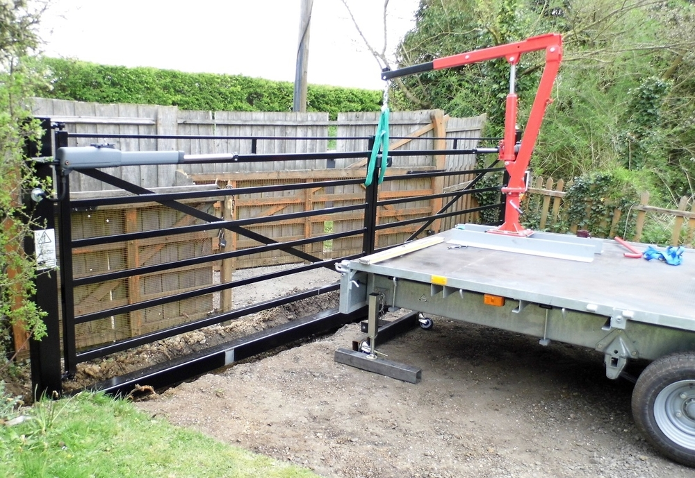 Gate being lowered into position and set up.