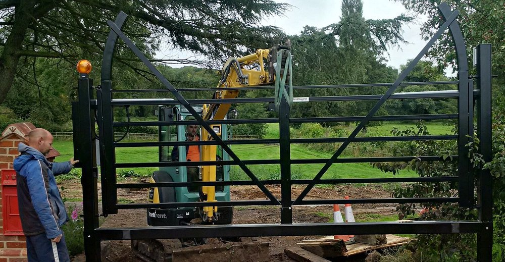 Assembled gate being installed..jpg