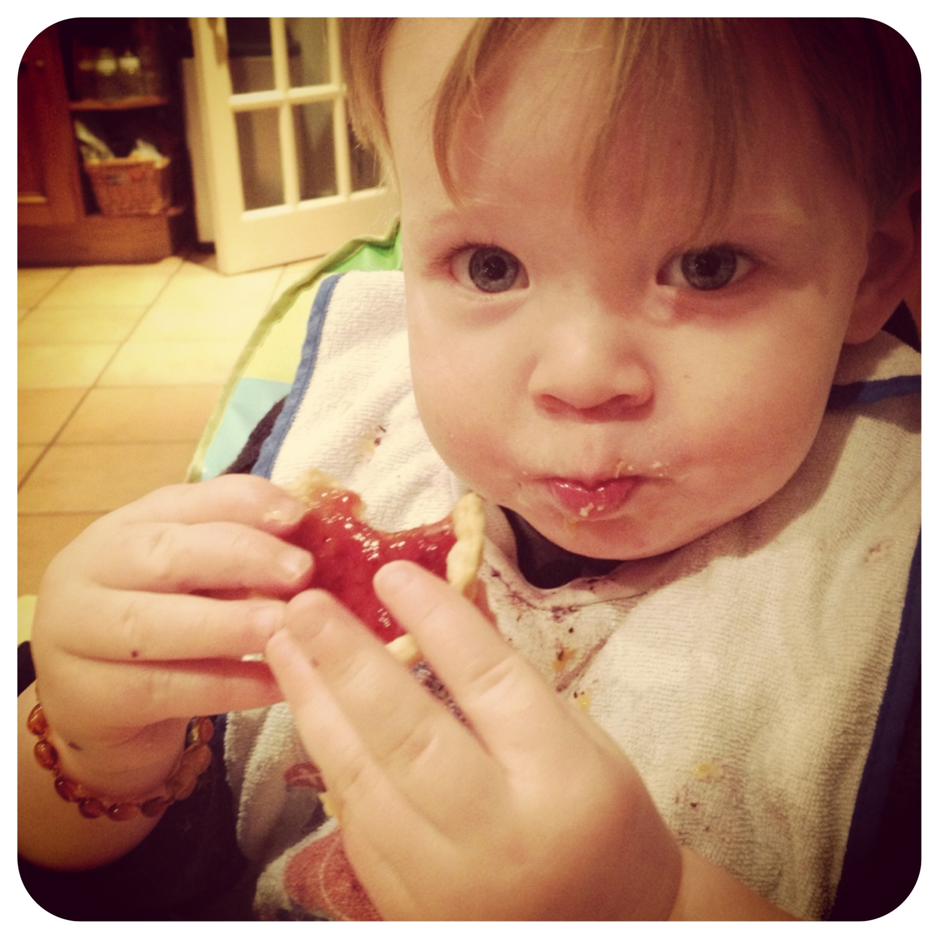 Oliver loving his Jam Tart