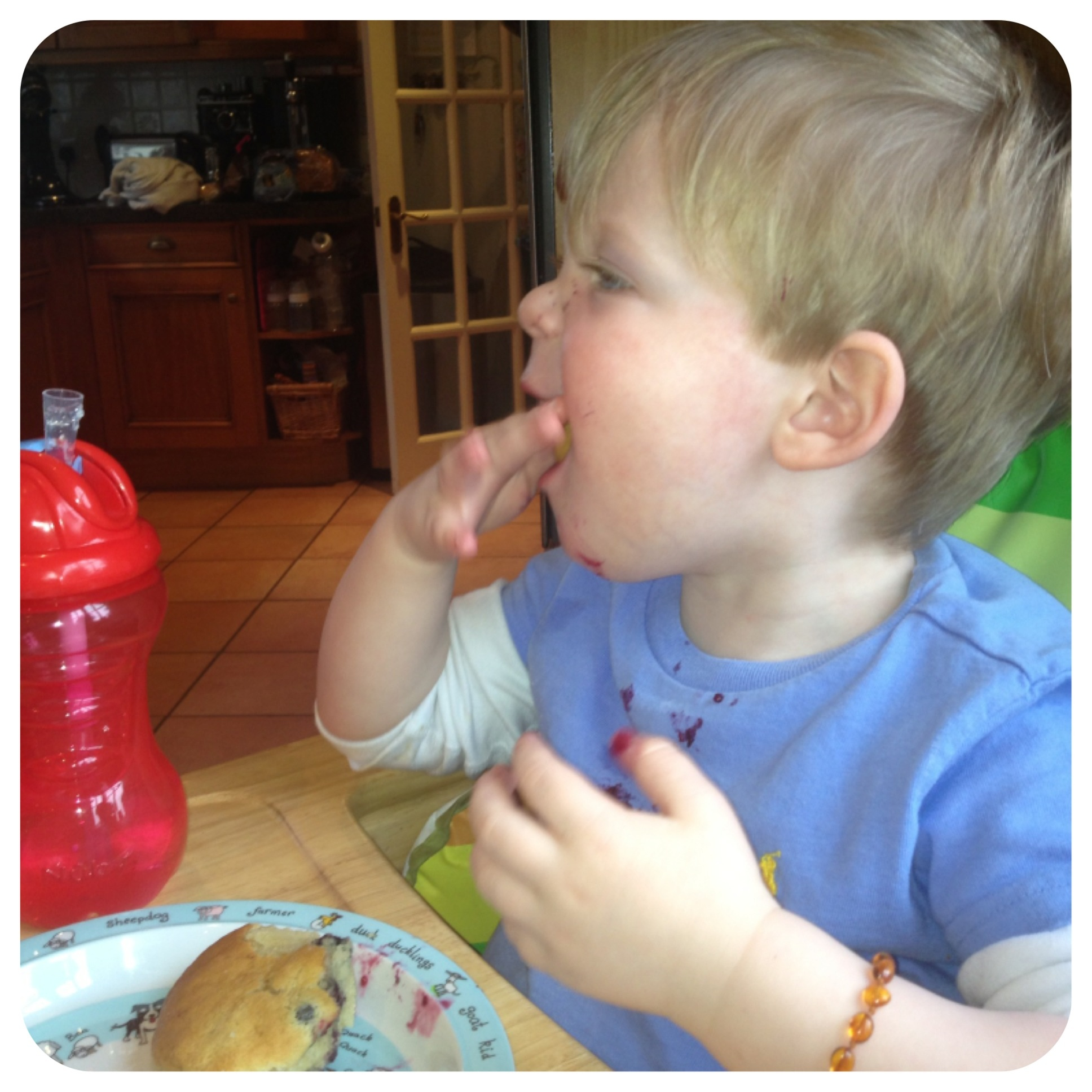 Oliver enjoying a muffin