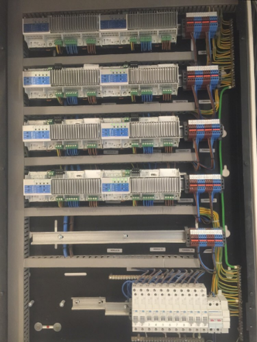 A Lutron QS system housed in a Future Automation enclosure.