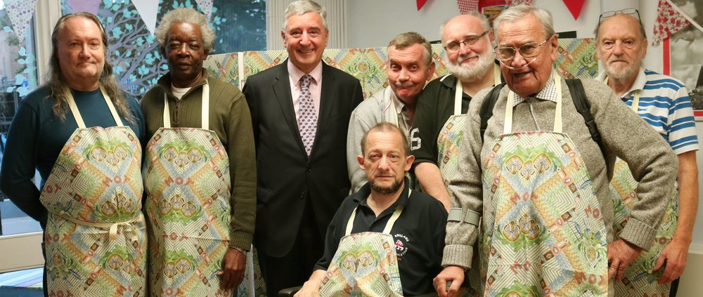 The Men's Cabin with MP Jim Fitzpatrick. Left to right = Rex; Clifton; (MP Jim Fitzpatrick); Dave; Paul (in wheelchair); Brian; Joseph; George.JPG