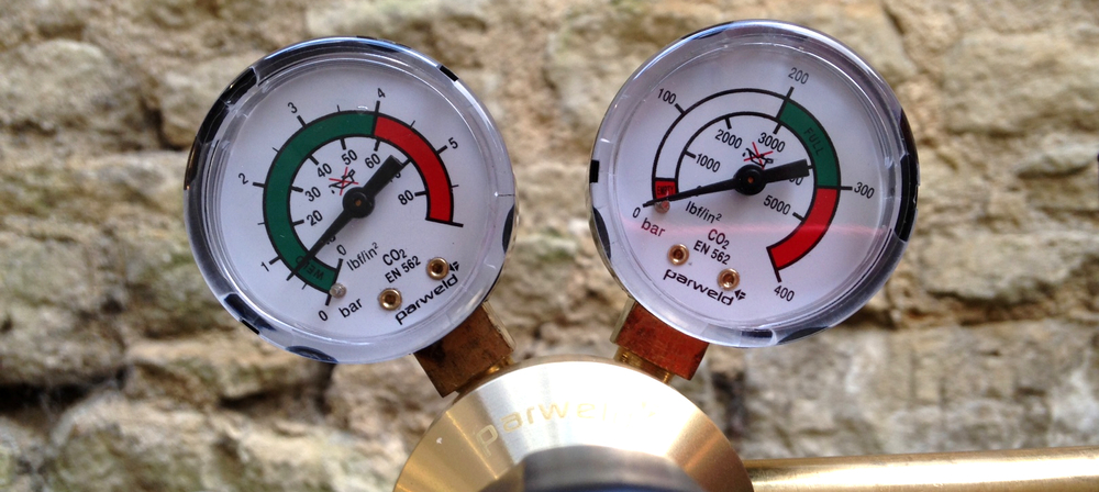 Here the left hand gauge shows the beer stored at 10 psi or lbf/in2 and the right hand gauge shows the gas canister is closed.