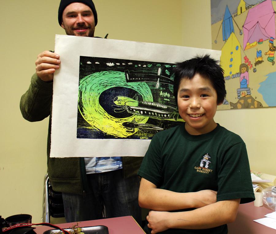Joanasie poses with his stellar two-layer linocut print