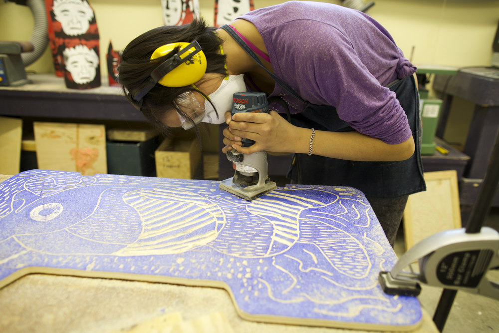 Reductive printmaking: After printing her block as a first layer, Susie carves into the same block again with a router to create a second layer