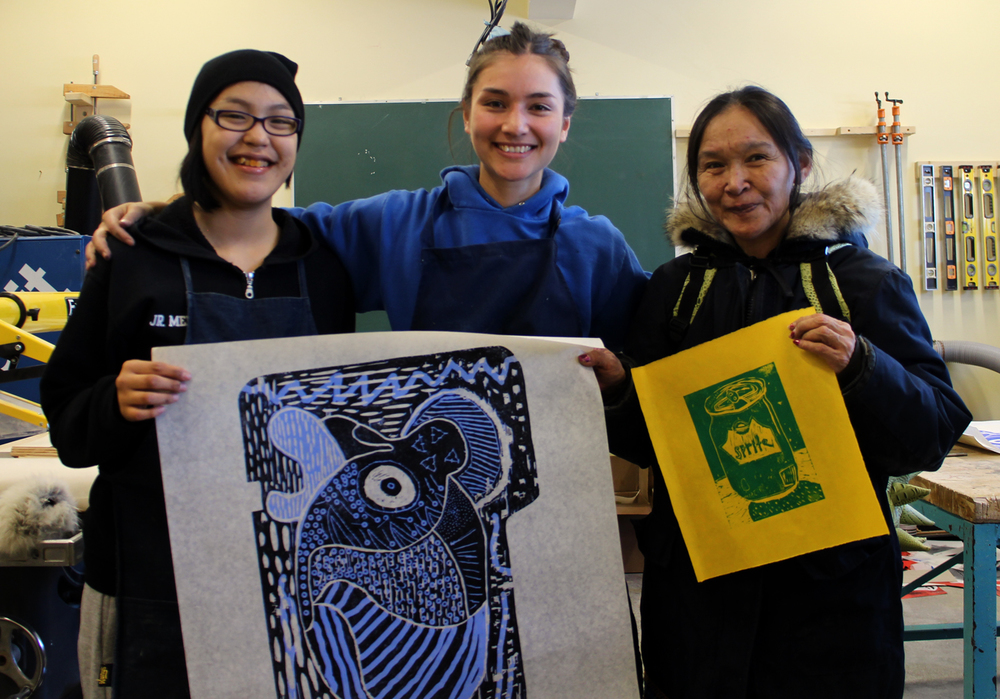 A very special day at Quviana Printshop: a visit from the wonderful and always poetic artist Shuvinai Ashoona! Left to right: Josie, Alexa, Shuvinai. Holding Susie and Nubeya's prints