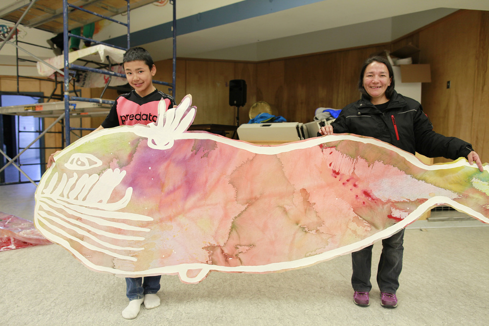 Latch and his mom hold up his amazing whale painting