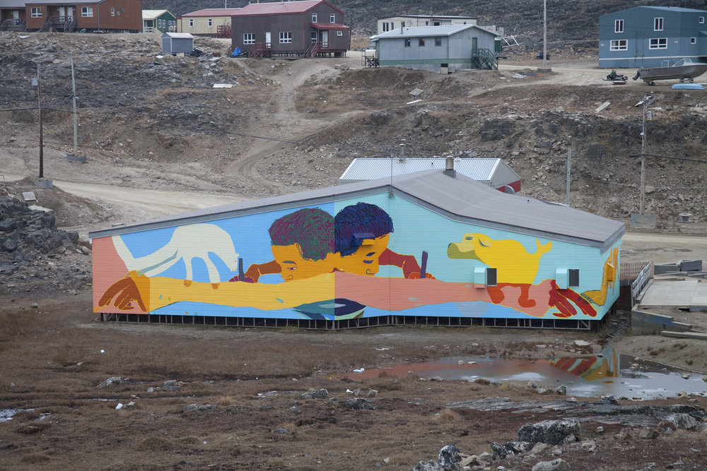 The back wall of the Community Hall. Drawings by Ooloota Quvianaqtuliaq (13), Johnny Samayualie (16), Jolly Saggiatuk (12), and Aggiu Ashevak (13).
