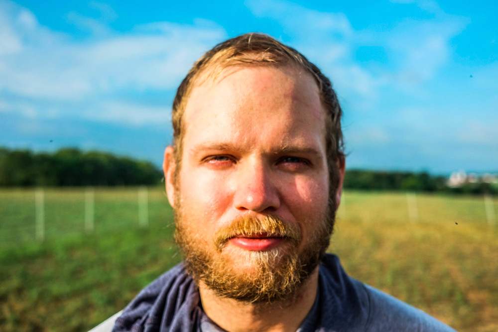 Farm hand Josh Schreck at Lima Family Farms. Photo by Derek Vaughan Brown.