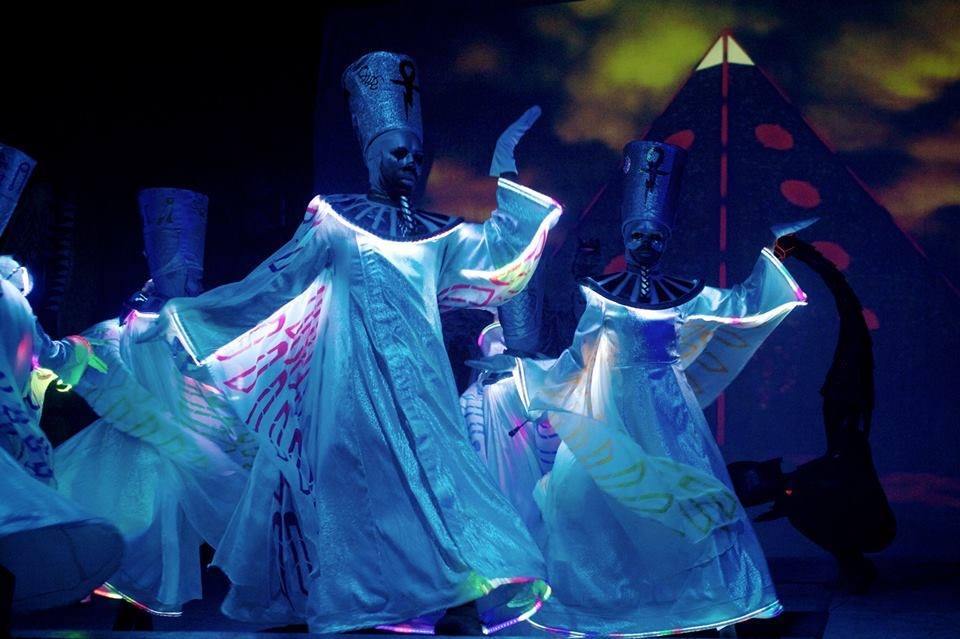 Scarabel dancers sporting lit costumes during BROS' Electric Pharaoh, 2014.