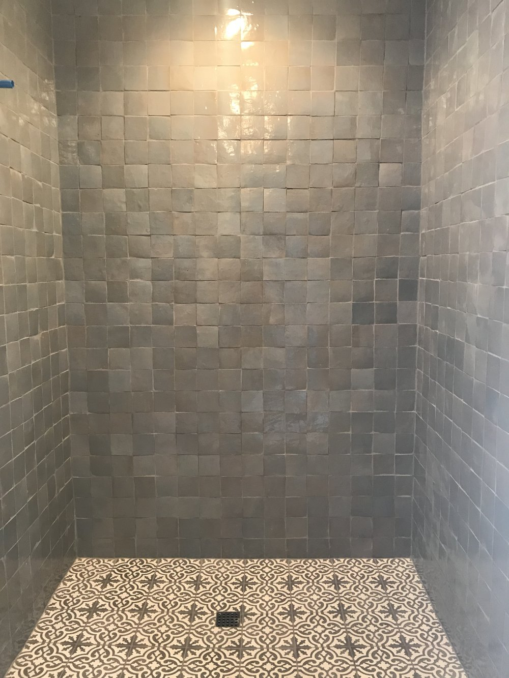 This is a pool house bathroom, I started with the  Shattered Pearl  4x4 Zellige tiles by Cle, and paired it with an 8x8  Mediterranean Cement Tile .
