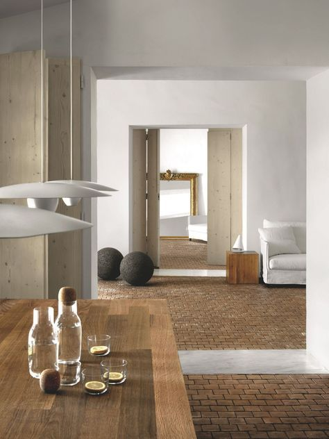Multiple wood tones, brick, concrete, linen, and brass all can act as color and add interest to a space without making it feel to active.