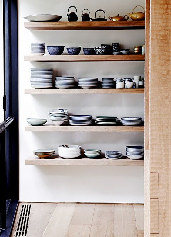 This is in no way minimalist, but what I will say that there is a color story, it has a neutral backdrop, and there is a rhyme and reason to the way in which this is organized. Image via Pinterest.