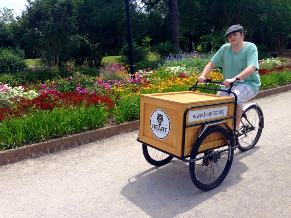 HeARTist, John Agostino enjoys riding the Dutch bicycle around Hampton Park