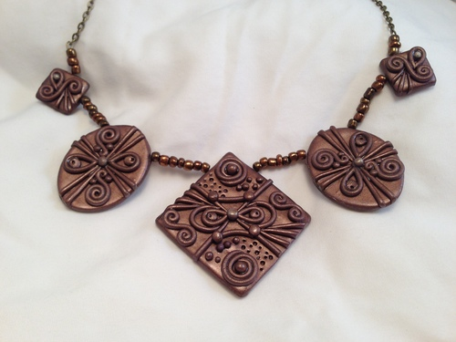 handcrafted artisan ornate bronze sculpted necklace