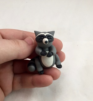 handcrafted curious raccoon figurinejpg