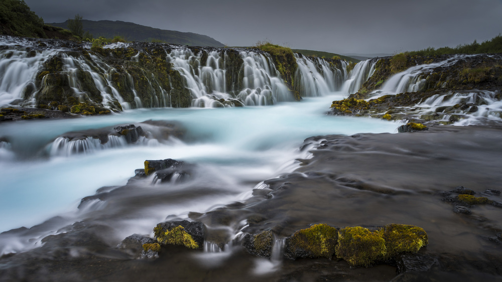 Brúarfoss waterfall in moody light.