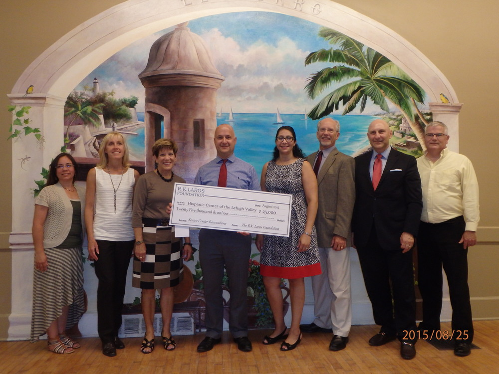 Laros Trustee George Mowrer presenting R.K. Laros Foundation grant to the Hispanic Center of the Lehigh Valley.
