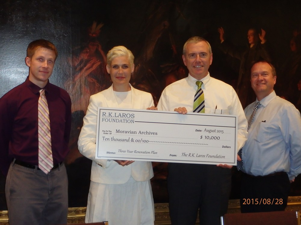 Laros Trustee Laura Bennett Shelton presenting the R. K. Laros Foundation grant at the Moravian Archives.