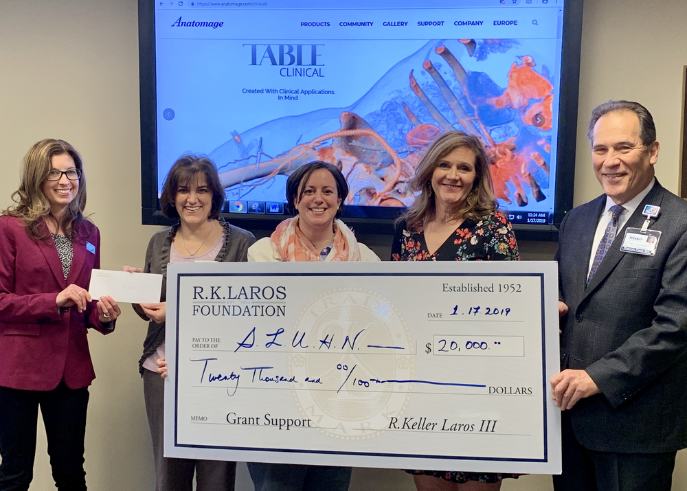 R.K.Laros' great granddaughter Elizabeth Shimer Bowers with Trustees Laurie Gostley Hackett and Dr. Michael Abgott presents the 2018 grant to Carla Arbushites Asst VP Development and Megan Augustine Network Simulation Director SLUHN on January 17th, 2019 in support of the purchase of a virtual anatomy table..