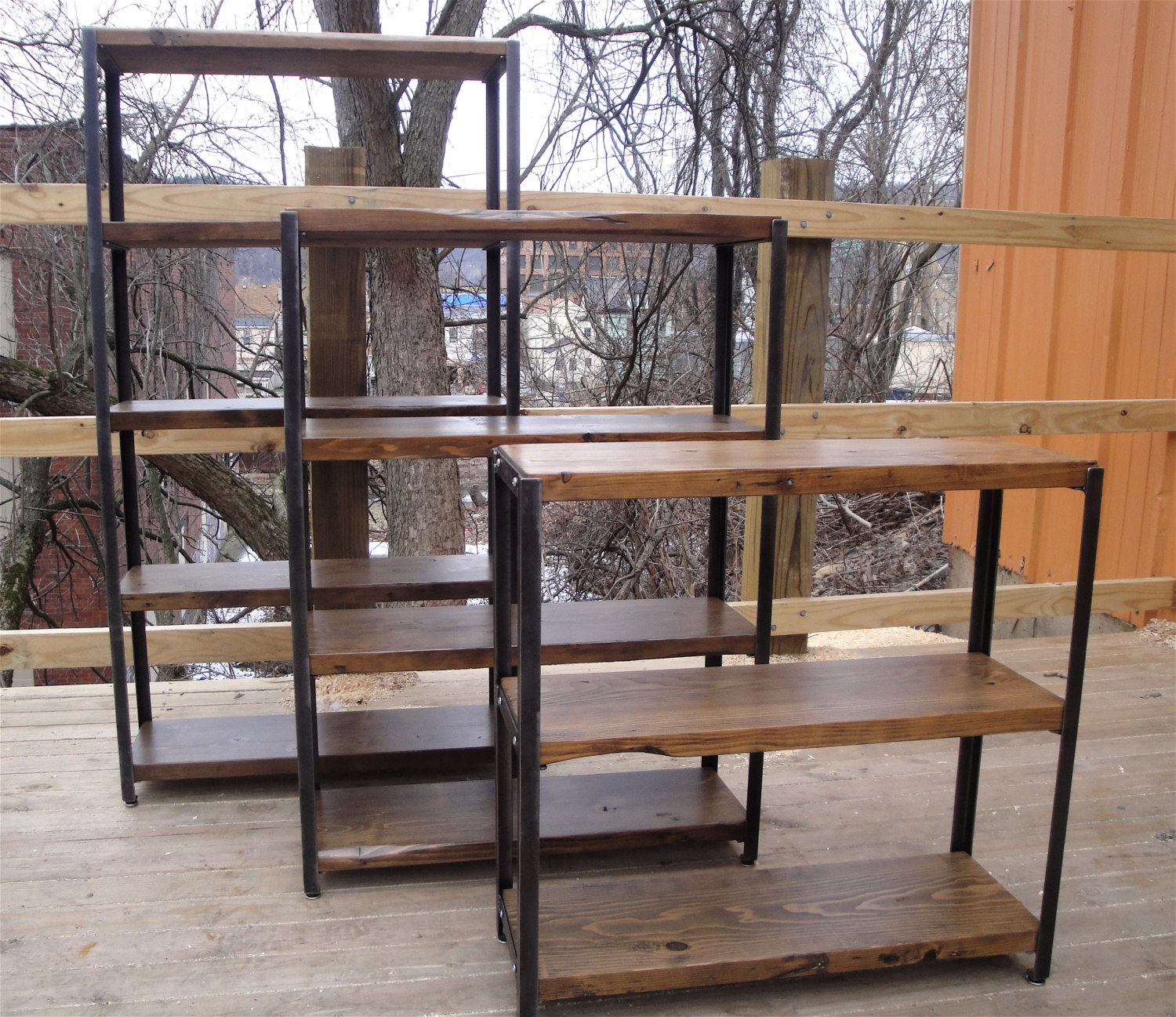 Bookcases made to order of reclaimed wood and recycled angle iron mid century industrial primitive furnishings
