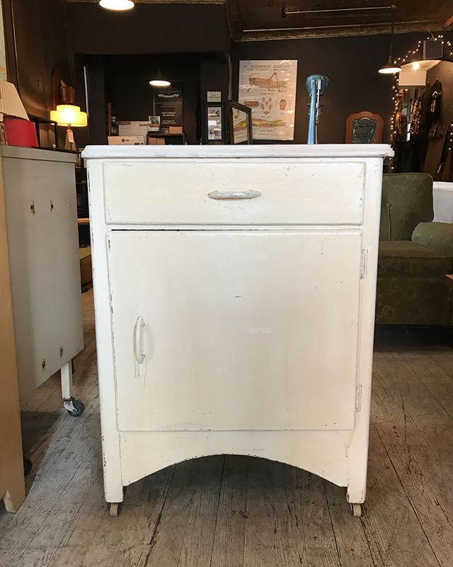 Small vintage cabinet on wheels