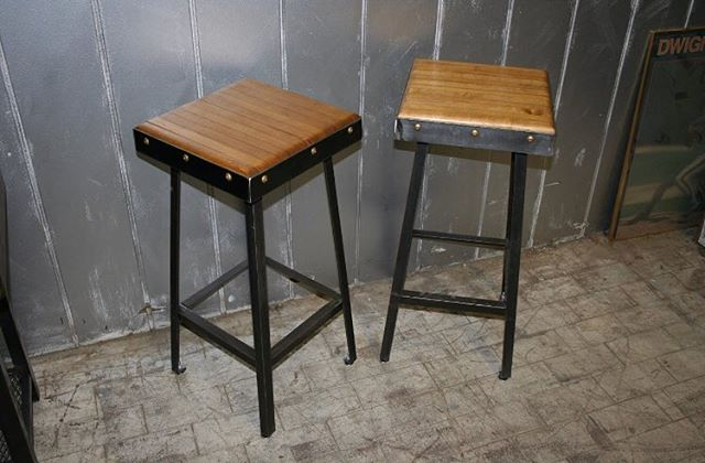 A pair of custom bowling alley stools we made