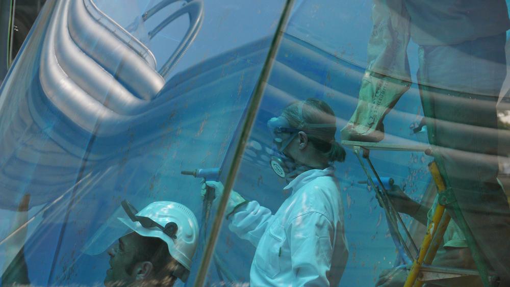 TGW 061511 THE GLASS WALL- artist Vicky Colombet and Cloud9 team members sandblasting glass and peeling vinyl  P1020645.jpg