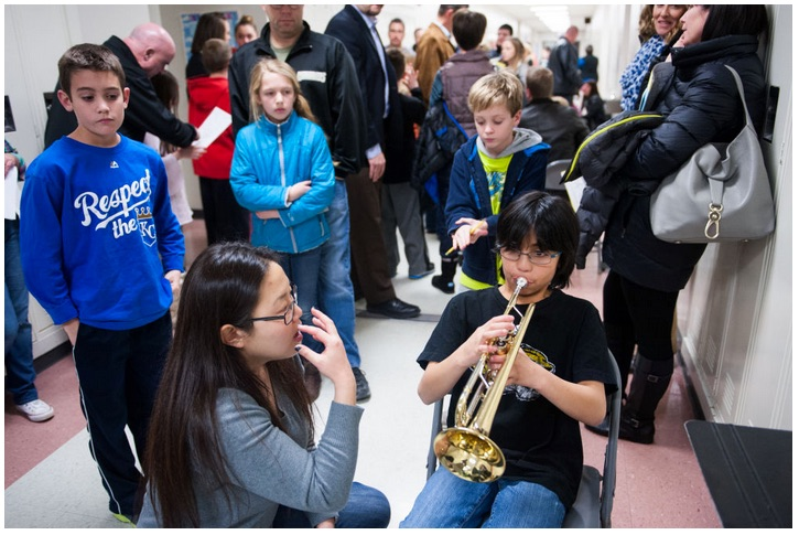 University of Missouri masters student Meredith Hammer instructs Jhon McBride, 11, on how to play the trumpet at one of the Columbia Public Schools' sixth grade band and orchestra enrollment nights Thursday at Gentry Middle School. Jhon has played the piano and violin in the past.