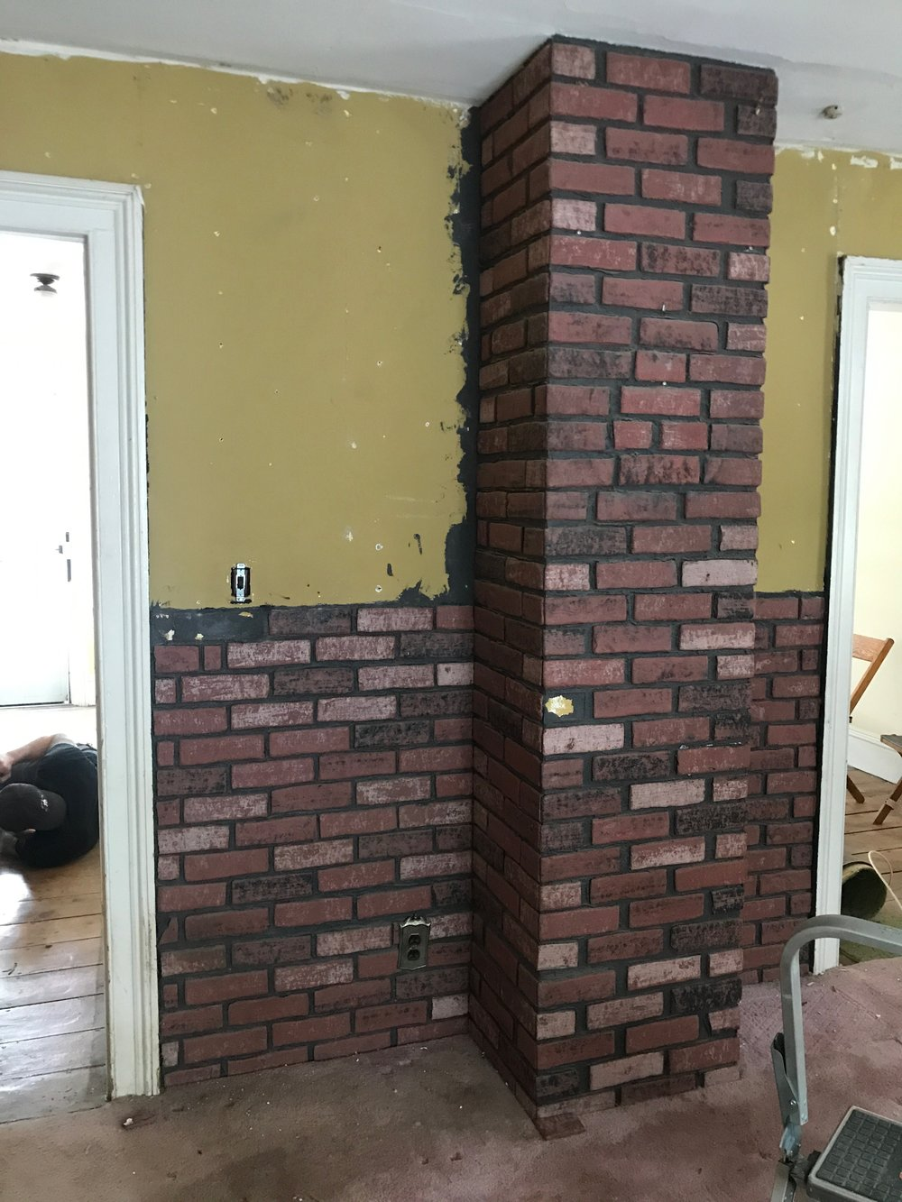 dining brick wall before.jpg
