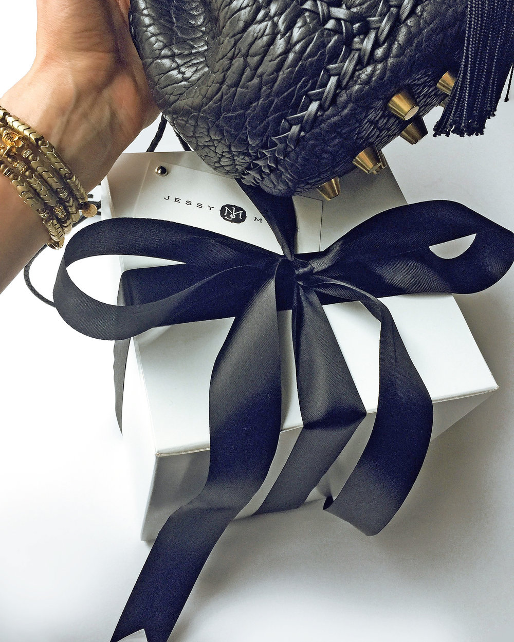 Mini bucket bag with gold hardware and  African Brass Snake Vertebrae Bracelets
