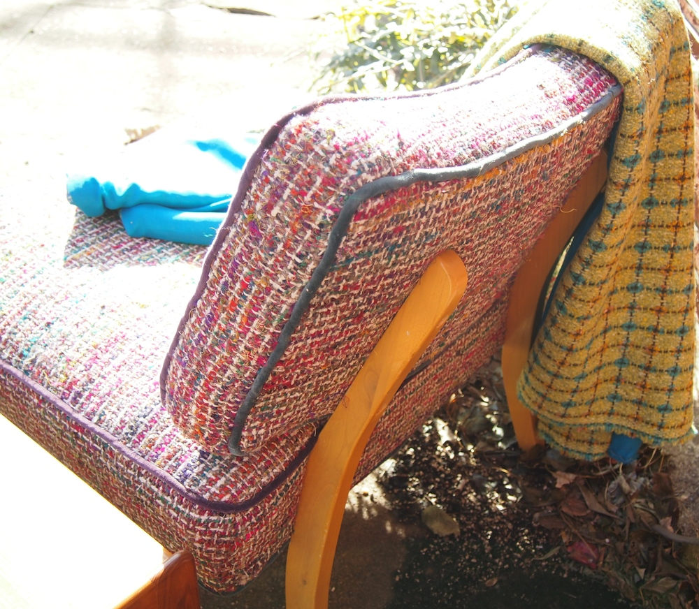 Natalie's Chair is almost wide enough for two--and is dressed in a tweed that evokes Chanel.