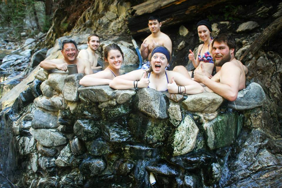 facebook.com   Some of the volunteers for The Wilderness Welcome Program enjoy their time relaxing in a natural hot spring after long hours of hiking.