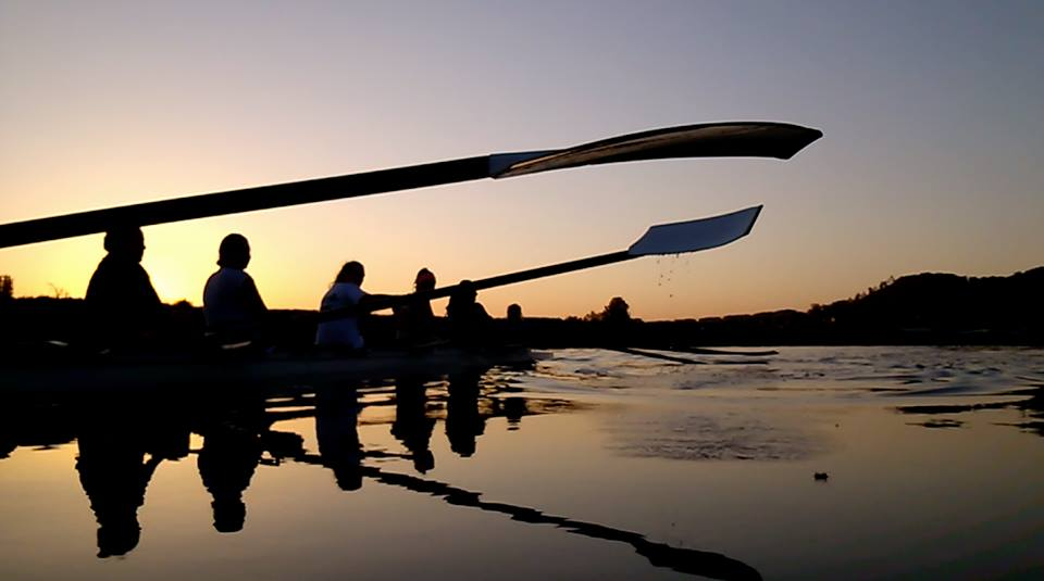 facebook.com The rowing club embraces teamwork in the early morning while enjoying the sunrise rowing in the bay.