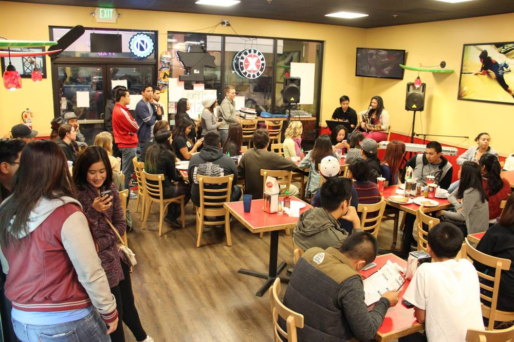 facebook.com   FAASSU holds various fundraisers, like an open-mic night at Extreme Pizza, pictured above, to raise money for Typhoon Hiyan relief.