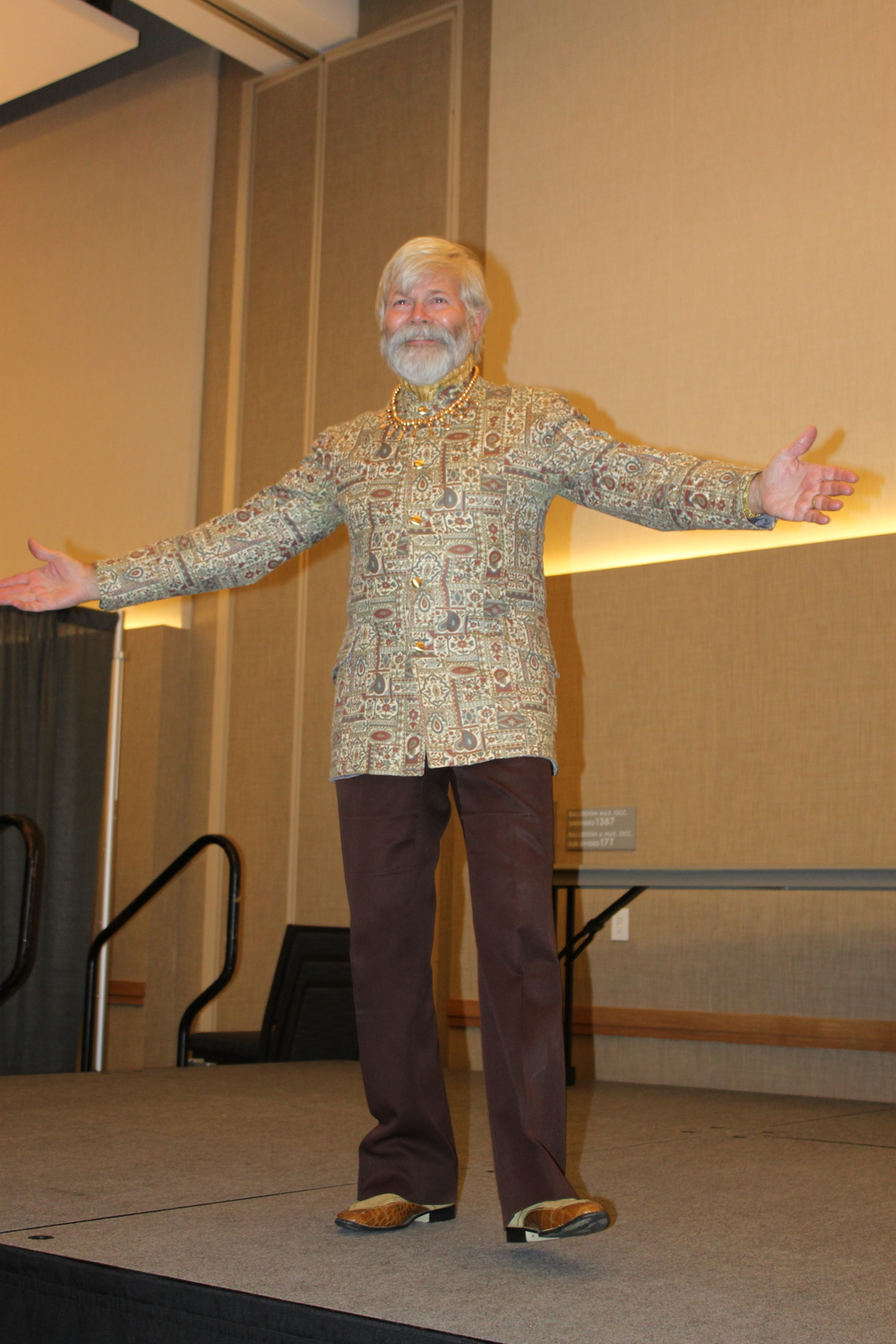 "COURTESY // Elizabeth  Schleth   Professor Rick Luttmann shows off his over-the-top suits and outfits in the ""Final Luttmann Fashion Show."""