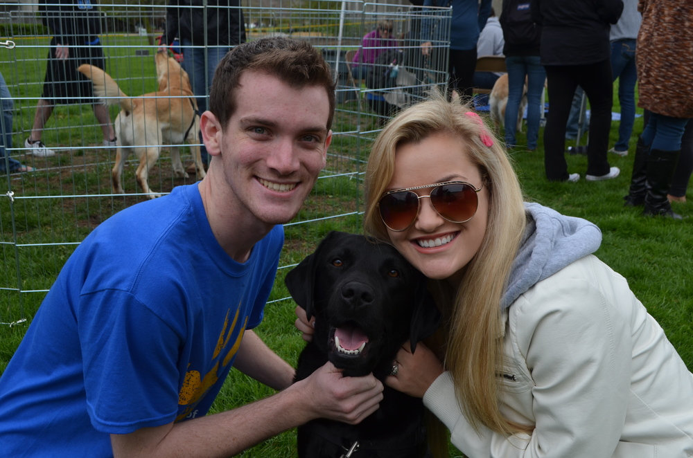 STAR // Cara Fuqua   Alpha Epsilon Pi hosted their philanthropy event, AEPuppies, last Thursday. Students were asked for small donations to get behind the tape and play with the puppies. Many students gathered to embrace puppies and receive puppy kisses, all in the name of charity.