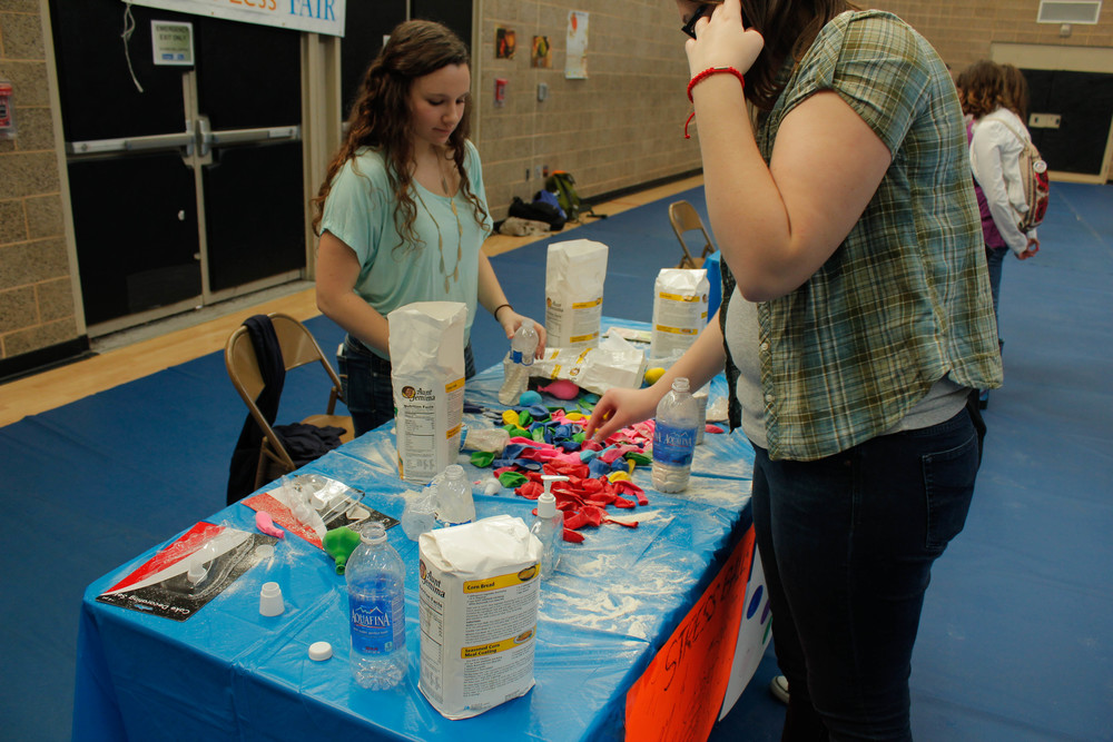 STAR // Melanie Hernandez A student makes their own stress ball out of rubber balloons and flour.
