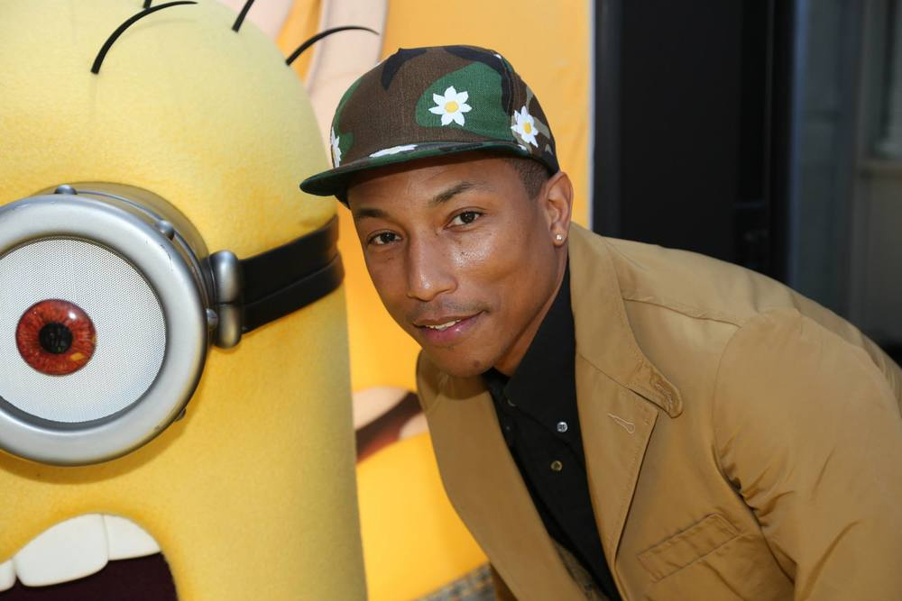 "facebook.com Pharrell Williams wrote, produced and performed the song ""Happy"" from ""Despicable Me 2."" Williams recently won the ""Producer of the Year"" award at the Grammys."