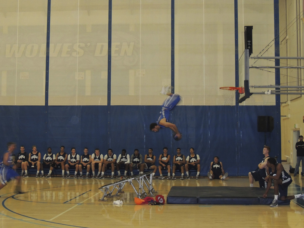 STAR // Alyssa James   Left, over 1,000 students and faculty were in attendance for Midnight Madness. Right, the main attraction of the night was the TNT dunk squad.