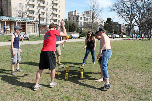 flickr.com   Spikeball is a combination of volleyball and four square played on a circular net-like trampoline.