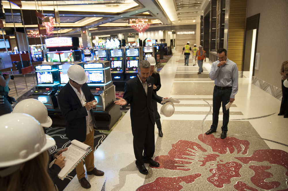 STAR // Connor Gibson Joe Hasson (center), general manager of Graton Casino and Rancheria, explains the detail of the casino's walkway with Tribe Chairman Greg Sarris (right).