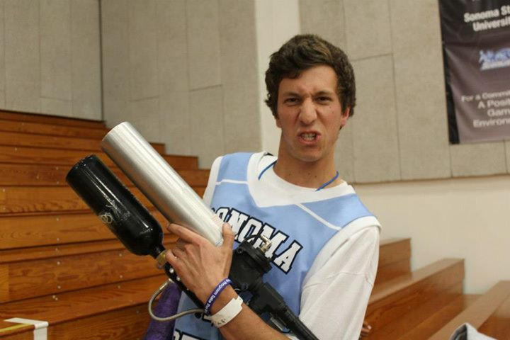 COURTESY // Jacob Harris Senior Jacob Harris wields a T-shirt gun in his left hand with a killer game face at sporting events.