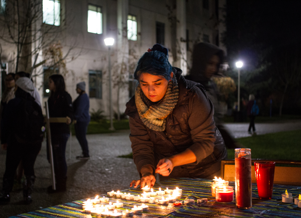 STAR // Gustavo Vasquez Emily Grawford, a Chicano and Latino studies major at Sonoma State University, lit candles in solidarity for the 43 missing college students in Mexico during a protest on campus Wednesday.