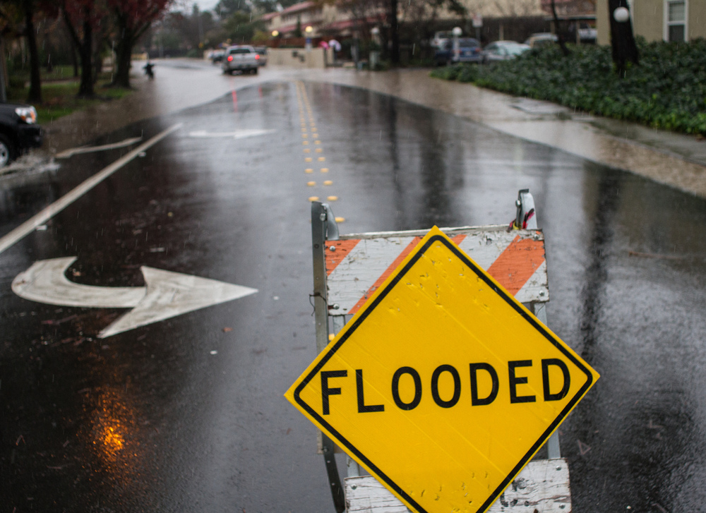 "STAR // Gustavo Vasquez ""Flooded"" side blocks Avram Avenue from Commerce Boulevard, entrance in Rohnert Park, after major storm hits Bay Area."
