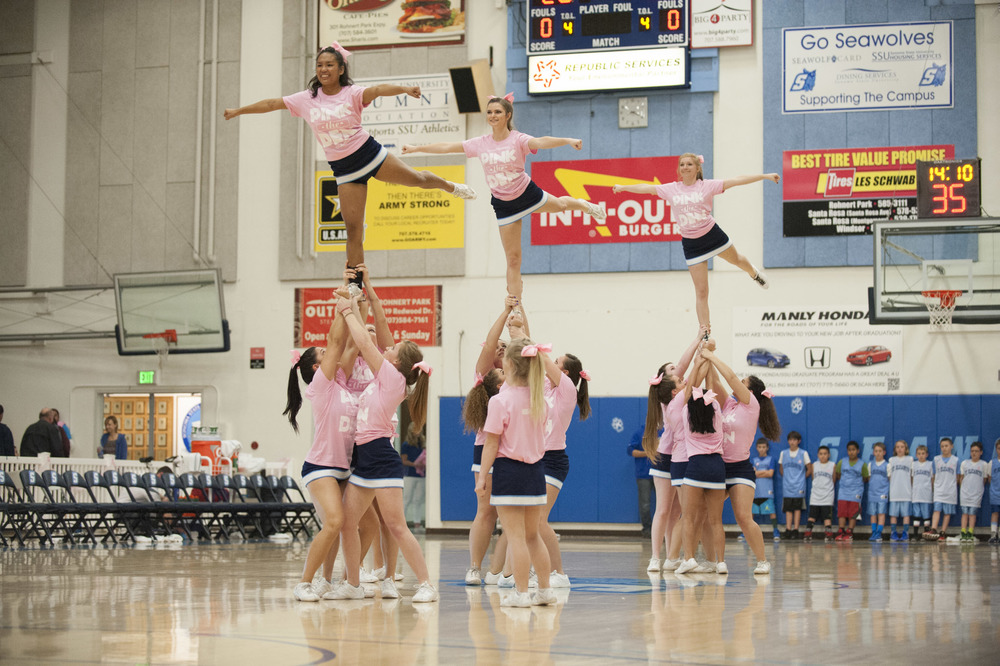 STAR // Connor Gibson The Sonoma State University Cheer team show off their routine as they are dressed in pink in support against breast cancer.