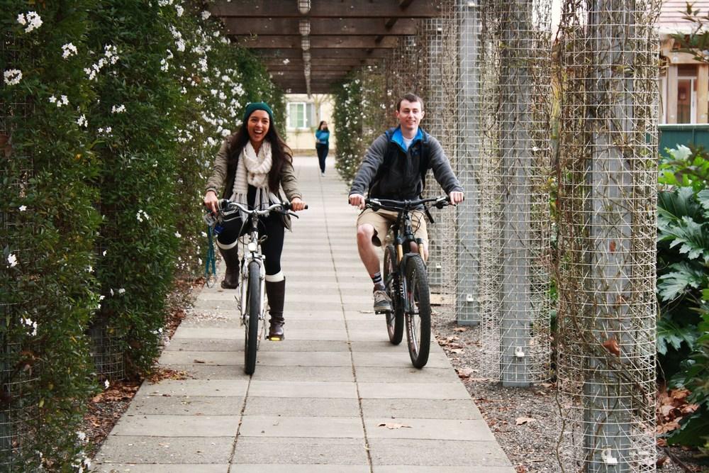 STAR // Niquie Wilson Breanna Pereira, 19, rides her bike home with her friend Josh Krisman, 20 on Thursday.