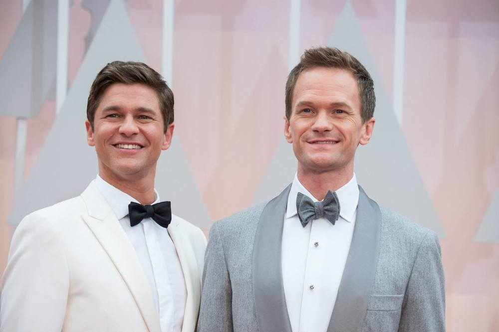 facebook.com   Oscar host Neil Patrick Harris and actor David Burtka on the red carpet.