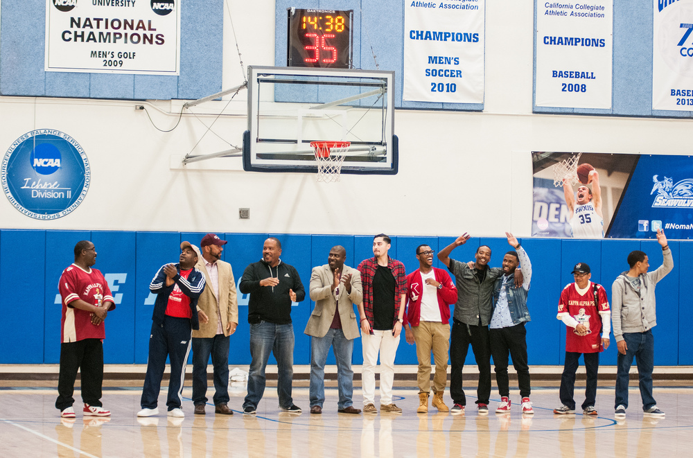STAR // Gustavo Vasquez   Members of Kappa Alpha Psi fraternity visited Senior Night on Saturday to show off their new banner and celebrate the fraternity's history.