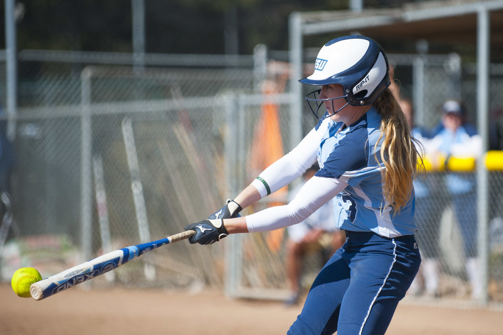 STAR // Connor Gibson    Junior pitcher Amanda Llerena finishes her motion versus CSU Dominguez Hills. Senior outfielder Keeley Ray makes gets a piece of the ball in her at bat.